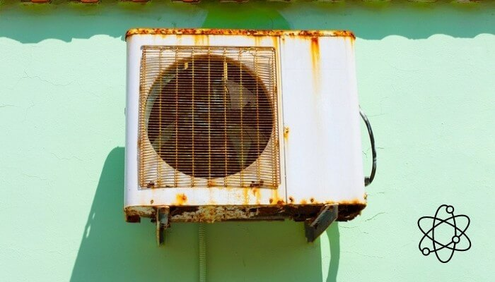 old rusted aircon outdoor unit